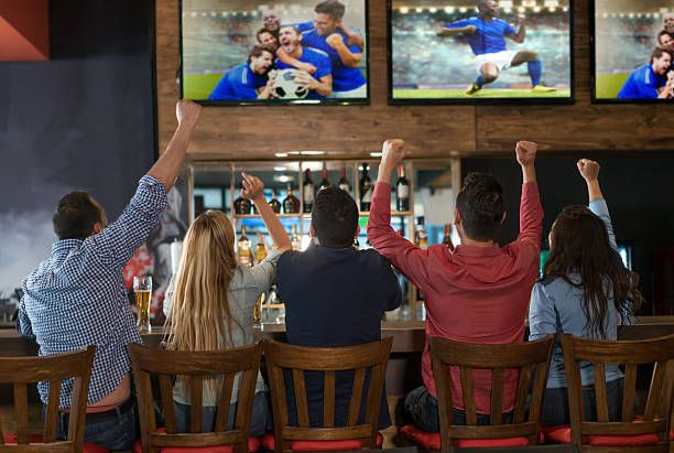 excited group of people watching the game at a sports bar and fun sports sports bar people excited group of people watching the