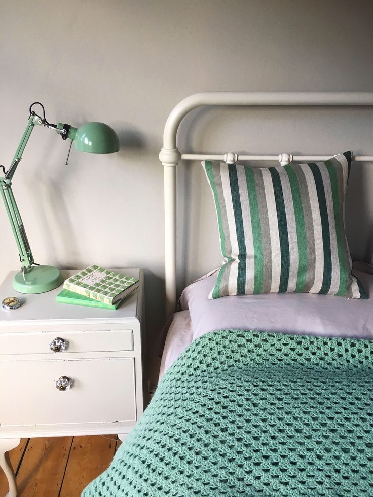 Green, taupe and cream striped herringbone linen (Zoffany Doric) cushion cover from my Etsy shop, teamed with vintage style bed, mint crocheted throw and IKEA lamp. https://www.etsy.com/uk/listing/589077409/ #linencushion #mintgreen #herringbonelinen #stripedlinen #joannanadin #ikealamp #rusticstyle #greendecor #vintagestyle #bedroomideas #bedroominspo #bedroomdecor #linenpillow #etsyseller #vintagedecor #zoffany #doric