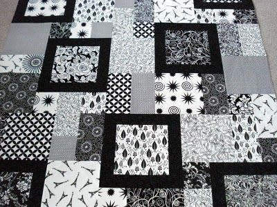 black and white quilts ~~ look familiar Sweetie?  Made a California King size black and white quilt for Heather and Jason.