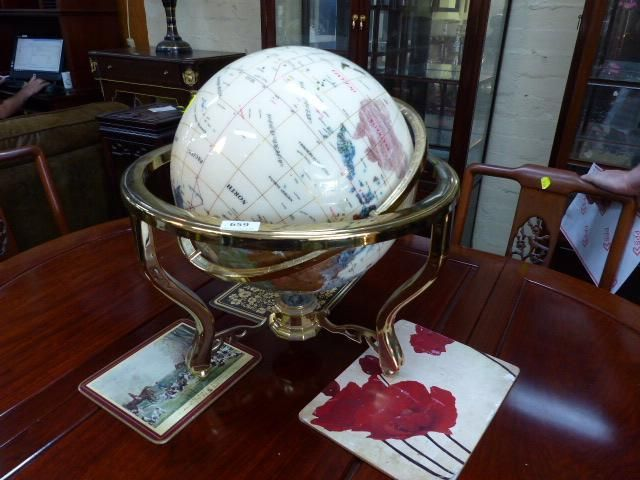 This unique world globe on brass stand has the countries depicted as various minerals. A great collectable.