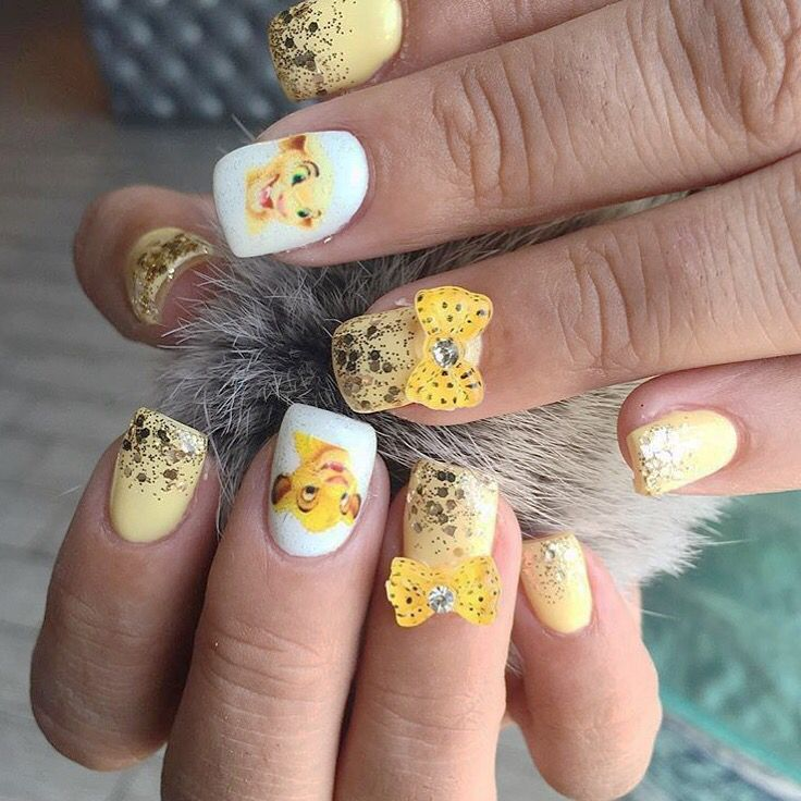 Lion king nails :) Looked amazing on my Disneyland trip!!