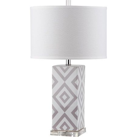 Fresh and graphic, the Diamonds table lamp by Safavieh brings a welcome pop of color to transitional rooms. Crafted of white ceramic with acrylic base and...