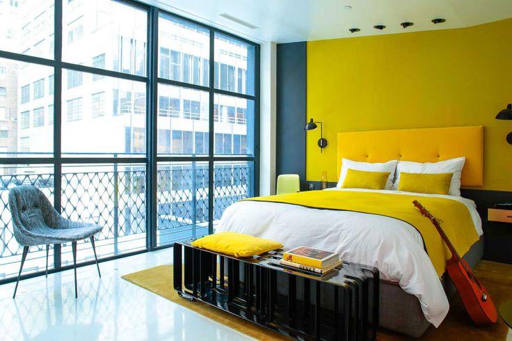 Дизайн интерьера номера в отеле с акцентом на желтые оттенки http://www.clavel.ru/