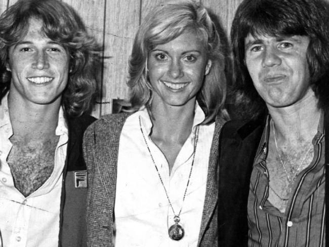 Andy Gibb (left) with Olivia Newton John and Daryl Braithwaite in 1977.