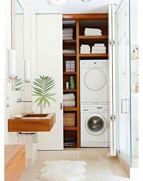 Laundry in the closet, shower and toilet in one room.  Not my style, but Great use of space.
