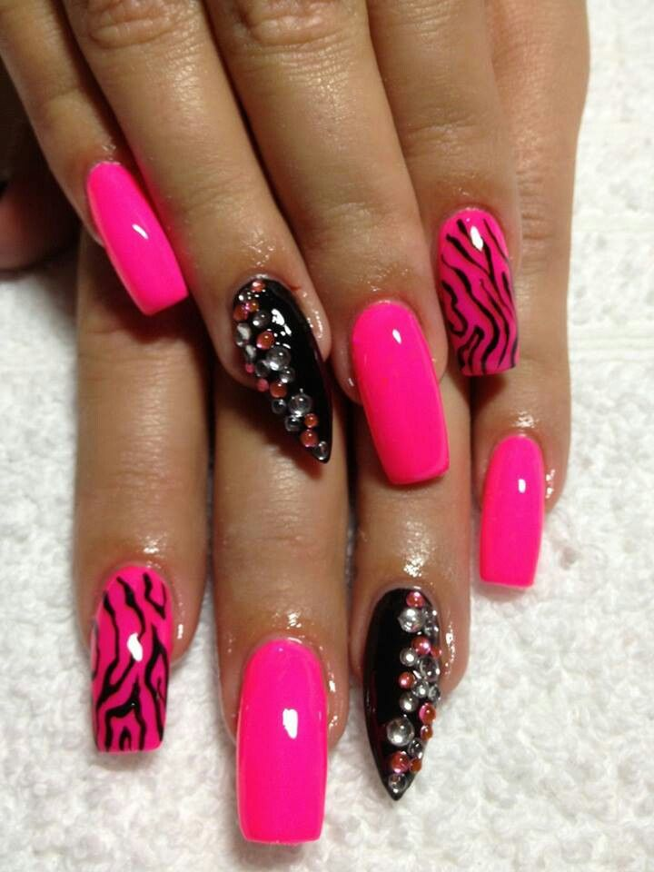 Pink zebra square nails with a stiletto nail on the ring finger