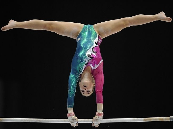And then there's Italian gymnast Carlotta Ferlito — here in a bold, shimmery teal, purple and silver combo. | 41 Of The Best, Most Extravagant Leotards From The 2013 World Gymnastics Championships