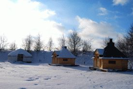 timber yurts in the snow on bindlebole wood