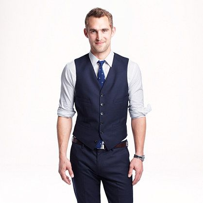 Suit vest and rolled up sleeves for the wedding