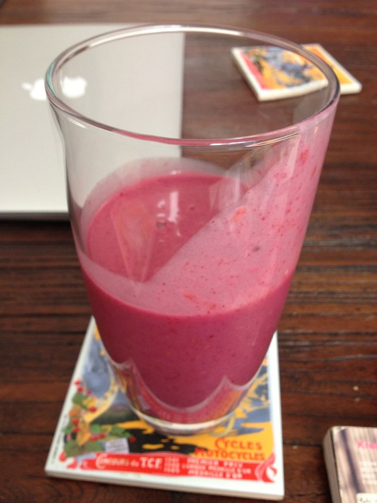Quick and healthy breakfast or post workout snack - 1 banana, half cup raspberries, rice milk and protein powder. Drink up!