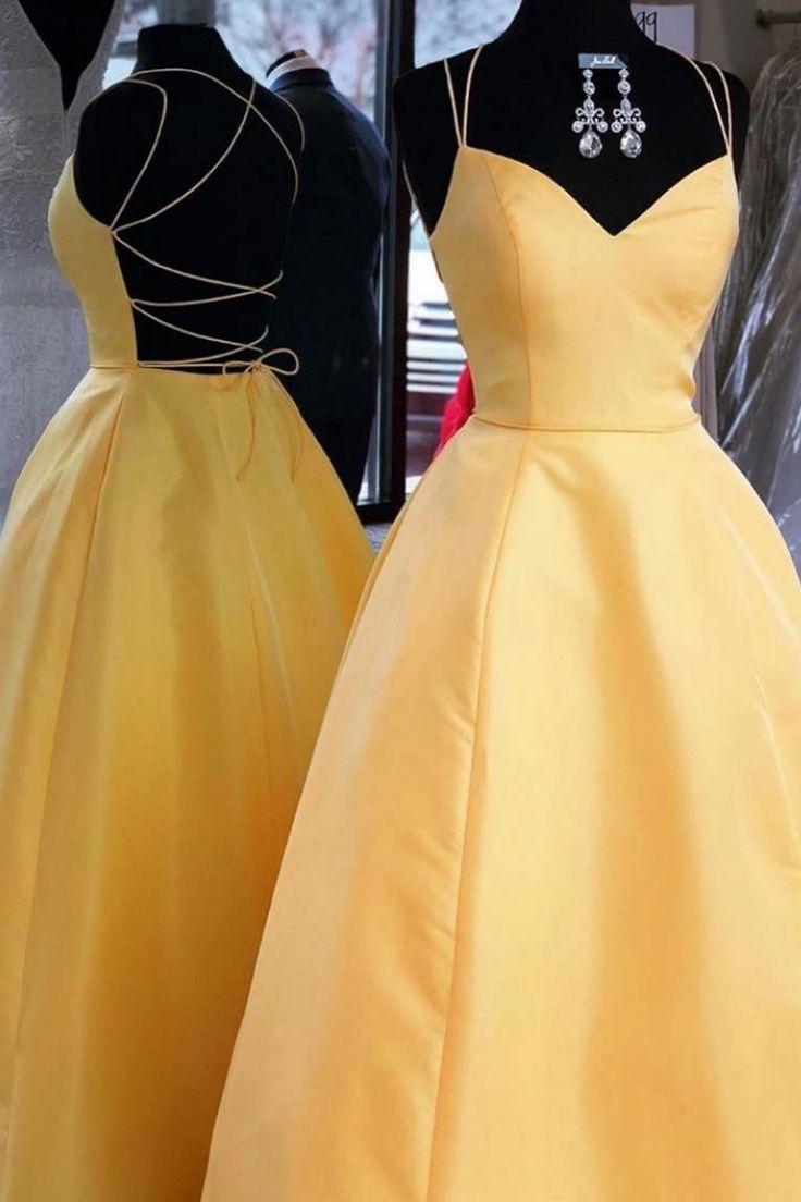 Elegantes gelbes langes Abendkleid mit Bindeband und Taschen