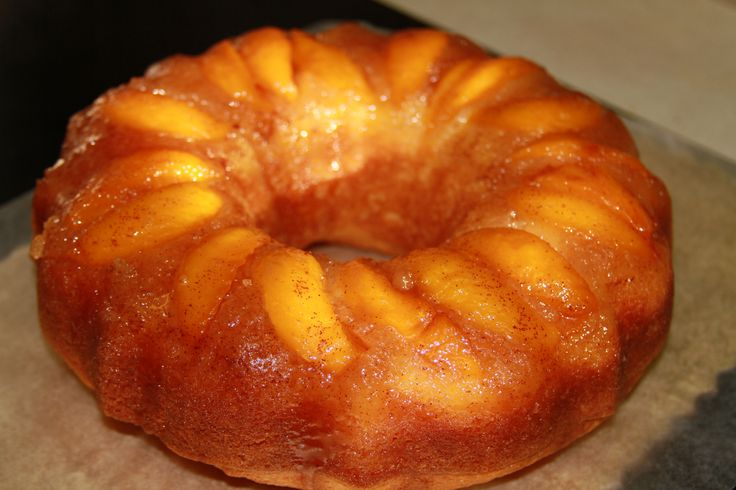 Peach Upside Down Cake: 1 can sliced peaches, 1 box Yellow Cake, 3/4-cup sugar, 3 tbsp butter, 1 tsp vanilla, 1/2 tsp ground cinnamon. Bring butter, sugar, cinnamon and vanilla to a boil in saucepan; remove from heat. Spray bunt pan with oil spray; arrange peach wedges in bottom of pan.  Pour sugar mixture on peaches. Prepare yellow cake as per box, using syrup from peaches as part of water.  Pour batter on top of peaches. Bake for 50 minutes at 350F. Cool for 10 minutes on rack, then…