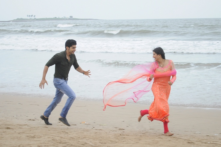 Yash and Aarti have fun on the beach