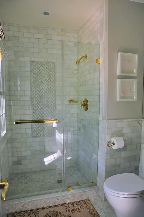A Seamless Glass Walk In Shower Door Accented With A
