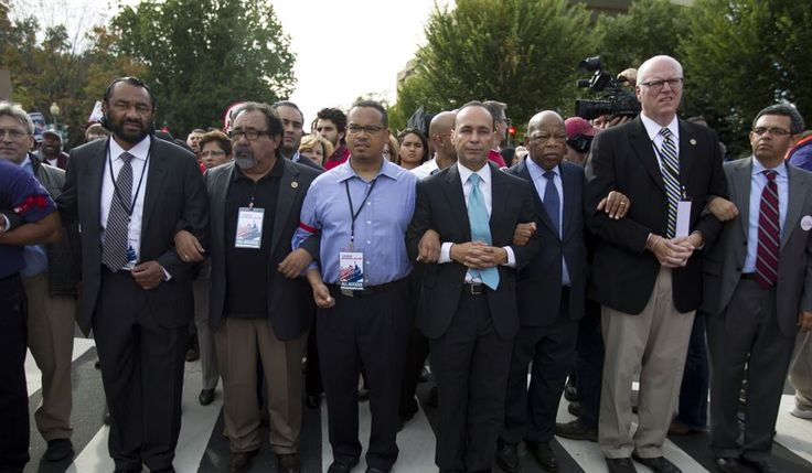From left, Rep. Al Green, D-Texas, Rep. Raul Grijalva, D-Ariz., Rep. Keith Ellison, D-Minn., Rep. Luis Gutierrez D-Ill., Rep. John Lewis, D-Ga., and Rep. Joseph Crowley, D-N.Y., second from right, march on Capitol Hill during a immigration rally in Washington. Mr. Grijalva told The Washington Times that the pay to a former female staffer was a severance package and that the agreement was reached without a complaint lodged with the Office of Compliance, which handles workplace grievances by…
