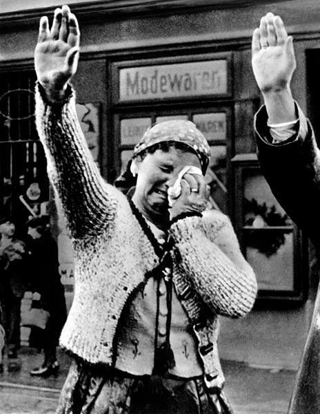Czech citizens having to greet invading German troops October 1938.