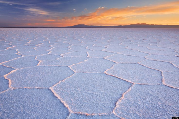 The Salar de Uyuni (Bolivia) is the world's largest salt flat, an arid surface of minerals stretching for miles that turns into the one of the planet's largest mirrors during the rainy season.