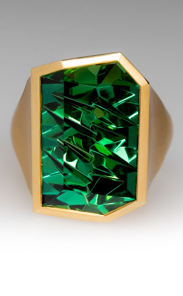 A striking designer Munsteiner green tourmaline ring in 18k gold