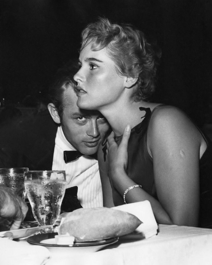 James Dean cuddles up to Ursula Andress
