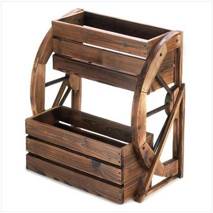 <p>Add a fresh touch of the country, complete with greenery, and enjoy your garden in a whole new way! Double-level planter features a quaint wagon wheel theme and rustic finish, with plenty of room to proudly show off your favorite blooms.</p>