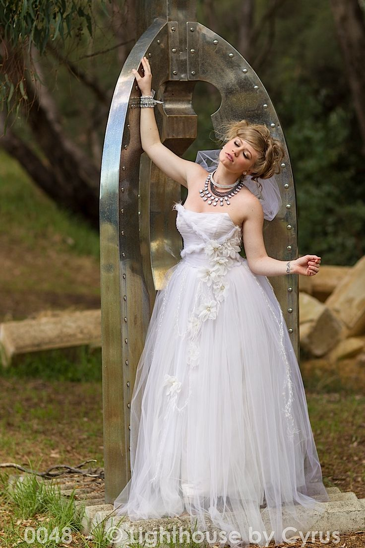 Strapless princess gown embellished with daisies and twisted tulle http://www.arcarocouture.com.au