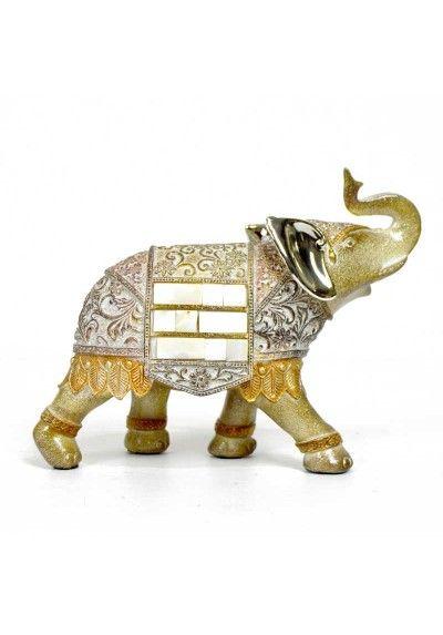 Elefante con trompa hacia arriba, representa la buena suerte y la prosperidad. Fabricada en resina con purpurina y detalles en nacar. Color beige, plata.  Figura decorativa para muebles auxiliares, estanterías, consola, mesa de centro... Envío en 24h.
