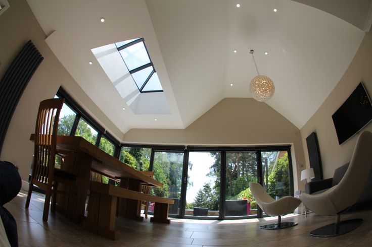 Internal view of graphite bifold doors and roof lantern.