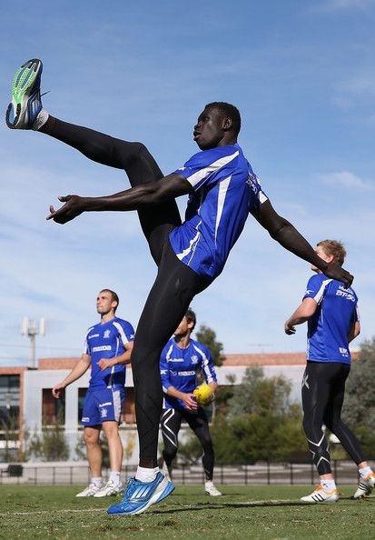 Majak Daw kicks for goal during a North Melbourne Kangaroos AFL training session at Aegis Park on May 14, 2013 in Melbourne, Australia.