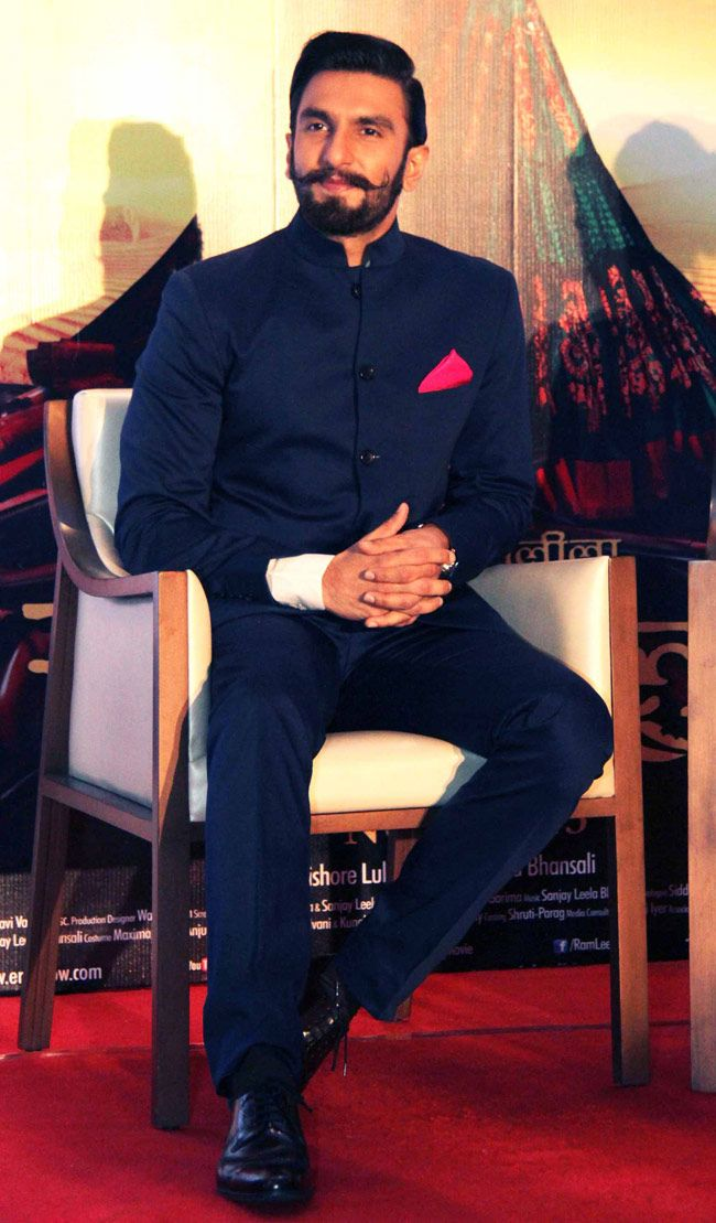 By designer Rohit Gandhi & Rahul Khanna. A very elegant Navy bandhgala suit with a pop of pink as a pocket square. Shop for your wedding trousseau , with a personal shopper & stylist in India - Bridelan, visit our website www.bridelan.com #Bridelan #Indiangroom