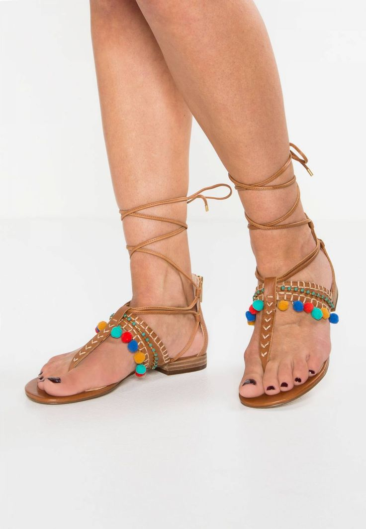 Vince Camuto. BALISA - T-bar sandals - whiskey barrel. Pattern:colourful. Sole:synthetics. Padding type:Cold padding. Shoe tip:open. Heel type:flat. Lining:imitation leather. detail:rhinestones,decorative seams. shoe fastener:zip. upper material:leathe...