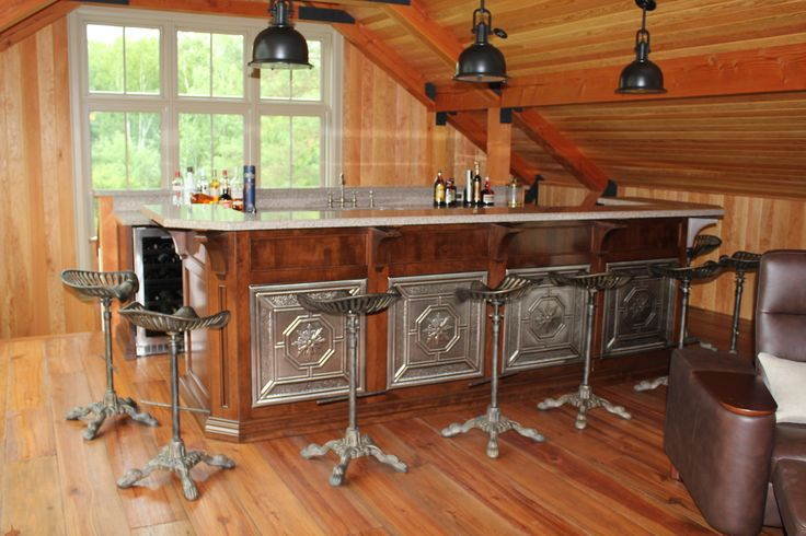 Custom solid maple bar with tin ceiling panels inset into the panels on front