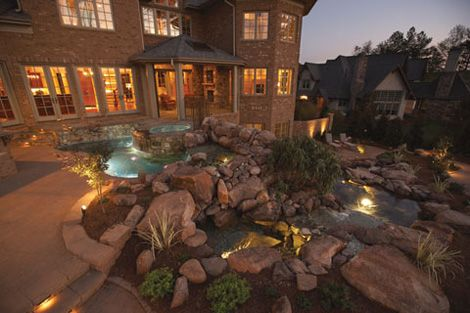 Landscape lighting can enhance water features and create a stunning effect over your pool at night. Aquatic Artists, Inc., Youngsville, N.C. http://www.poolspaoutdoor.com/pools/inground-pools/articles/pool-designs.aspx