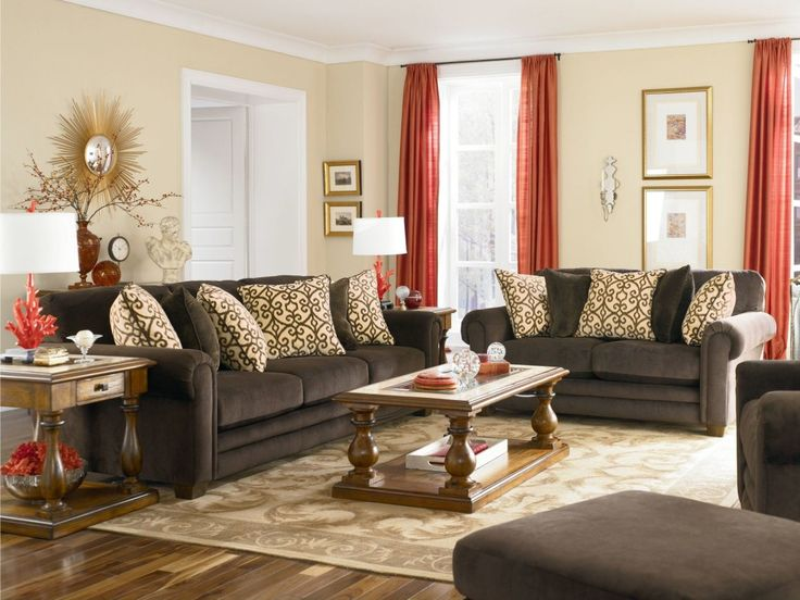 Attractive Living Room Sofa Designs Decorating Ideas With Dark Grey Sofa Set And Brown Pattern Cushion Also Wooden Coffee Table Plus White Glass Window With Red Curtain And Beige Wall Paint Color As Well As Interior Designs And Interior Decorating of Rema