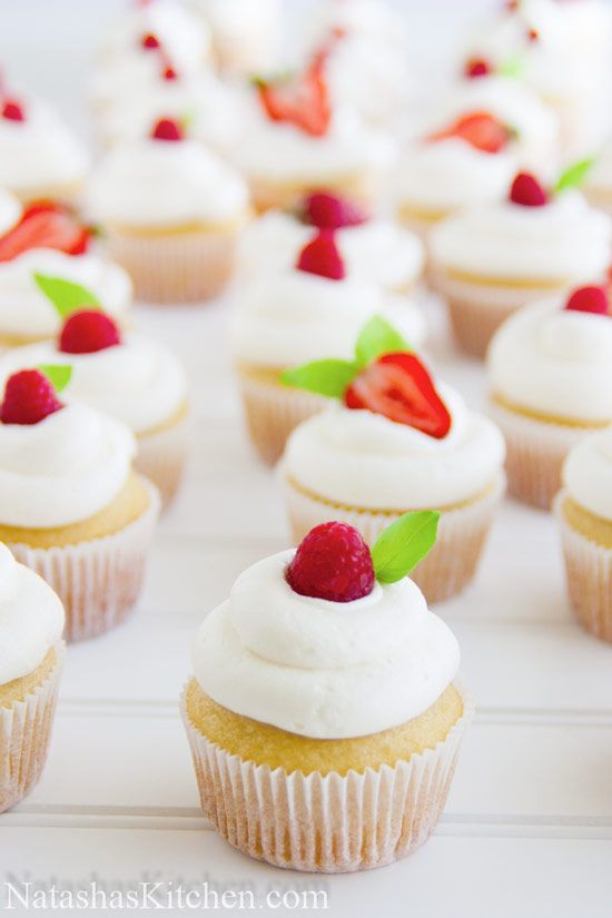 PERFECT Vanilla Cupcakes. Fantastic & truly perfect cupcake recipe, decorated with raspberries or halved strawberries and basil leaves #easy #cupcakerecipes http://thecupcakedailyblog.com/perfect-vanilla-cupcakes/