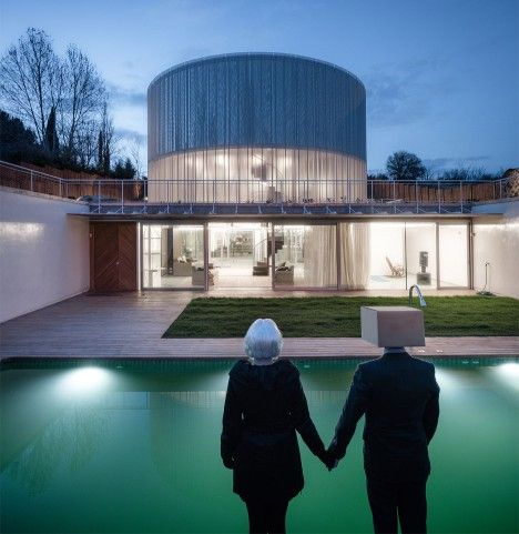Futuristic house in Madrid comprising three corrugated cylinders raised on stilts