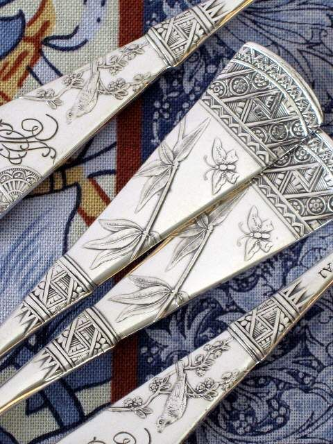 """Japanesque silver pattern flatware -       1879 Japanese (Various makers)  Aesthetic (Eastlake) Victorian  Rated """"Collectible"""".  Very, very sought after.  Features butterfly and bamboo.  Beautiful pattern on back incorporates cherry blossom and a nightingale."""
