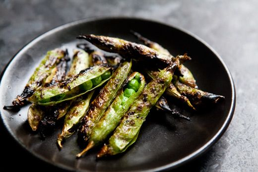 Fresh English peas, in their pods, slathered with olive oil, sprinkled with salt, and grilled. Eat like edamame.