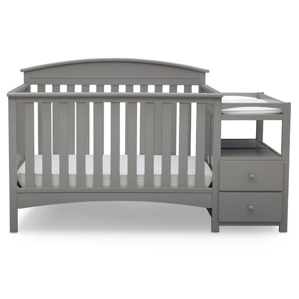A convertible crib that grows with baby, a convenient changing table, even a storage piece: You'll find so many ways to use the Abby convertible crib 'N' changer from Delta Children. The adjustable crib features three different mattress height positions, and converts to a toddler bed, daybed and full size bed to accommodate changing needs (Toddler guardrail and full size bed frame sold separately). Plus, the attached changing table with water resistant changing pad sits above two spa...