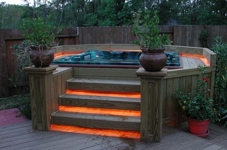 wooden hot tub deck idea instead of in ground. Maybe not the orange lights, but a different color
