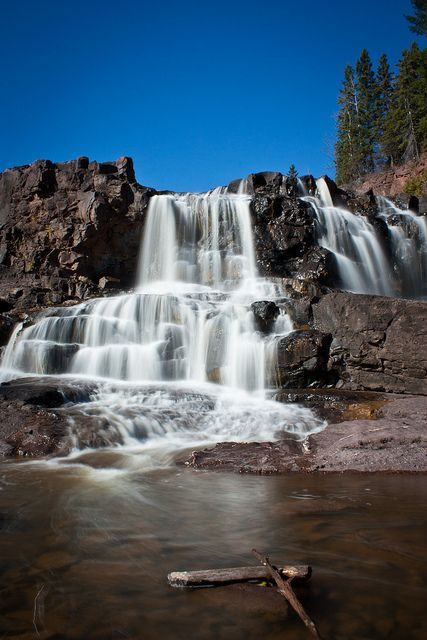 Gooseberry Falls, Two Harbors, Minnesota in 2000. I took a picture in front of these falls. A year later I found a pic of my grandma, in similar pose. So awesome.