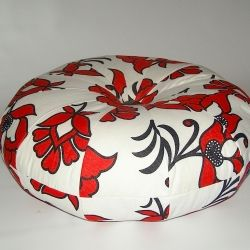 A beautiful pouf made with East African kanga fabric. Great to add a splash of colour to any room!