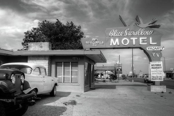Blue Swallow Motel - Historic Route 66 Icon - Black And White Art Print by Gregory Ballos.  All prints are professionally printed, packaged, and shipped within 3 - 4 business days. Choose from multiple sizes and hundreds of frame and mat options.