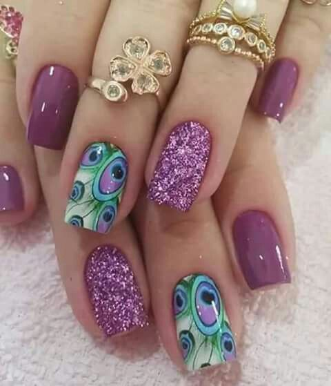 Pretty purple nails with glitter nail and handpainted peacock feather accent nails