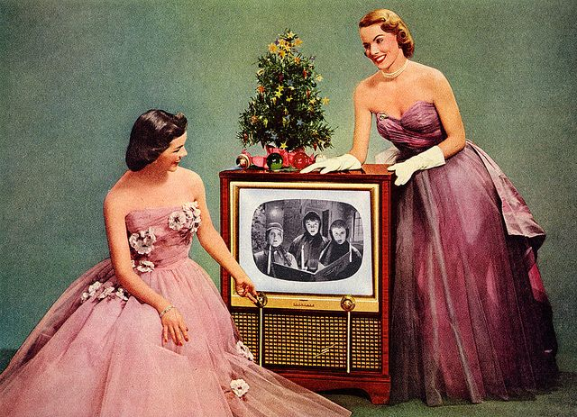i used to love sitting with my sister by the tv at Christmastime, in our evening gowns.