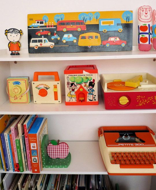 Jane Foster's daughter's shelves with her vintage Fisher Price radios and record player.