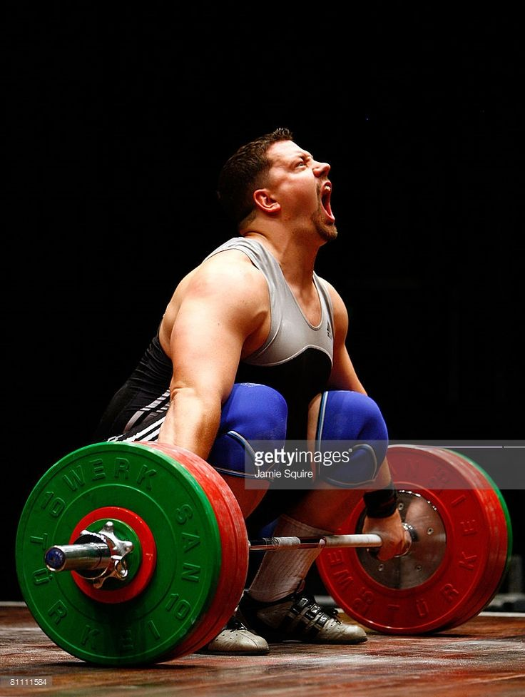 Jason Starks attempts a lift during the Men's snatch competition of 2008 Olympic Weightlifting Trials at the Robert Ferst Center for the Arts May 16, 2008 in Atlanta, Georgia.