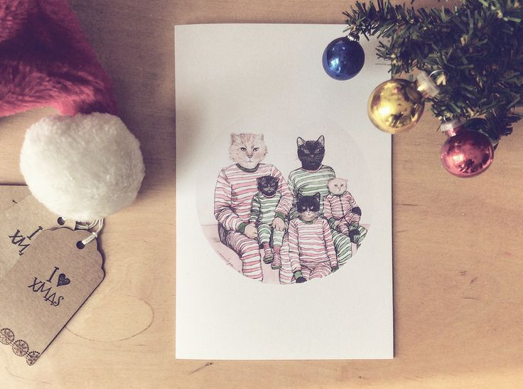 Cute family cat in pijamas for christmas cards