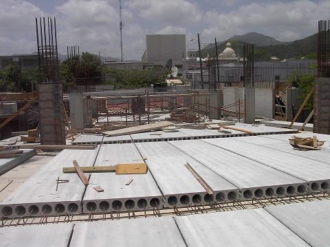 A hollow core slab, also known as a voided slab or hollow core plank, is a precast slab of Prestressed concrete typically used in the construction of floors in multi-story apartment buildings.  A Hollowcore slab offers the ideal structural section by reducing dead weight while providing the maximum structural efficiency within the slab depth.