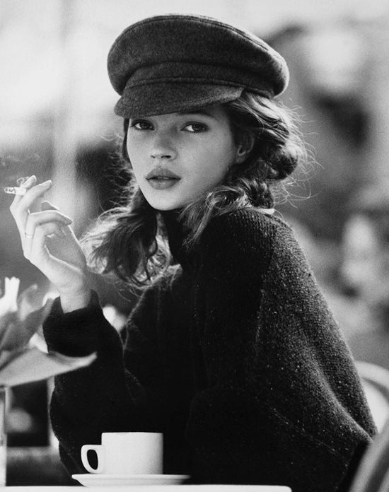 Kate moss having a coffee and a cigarette.