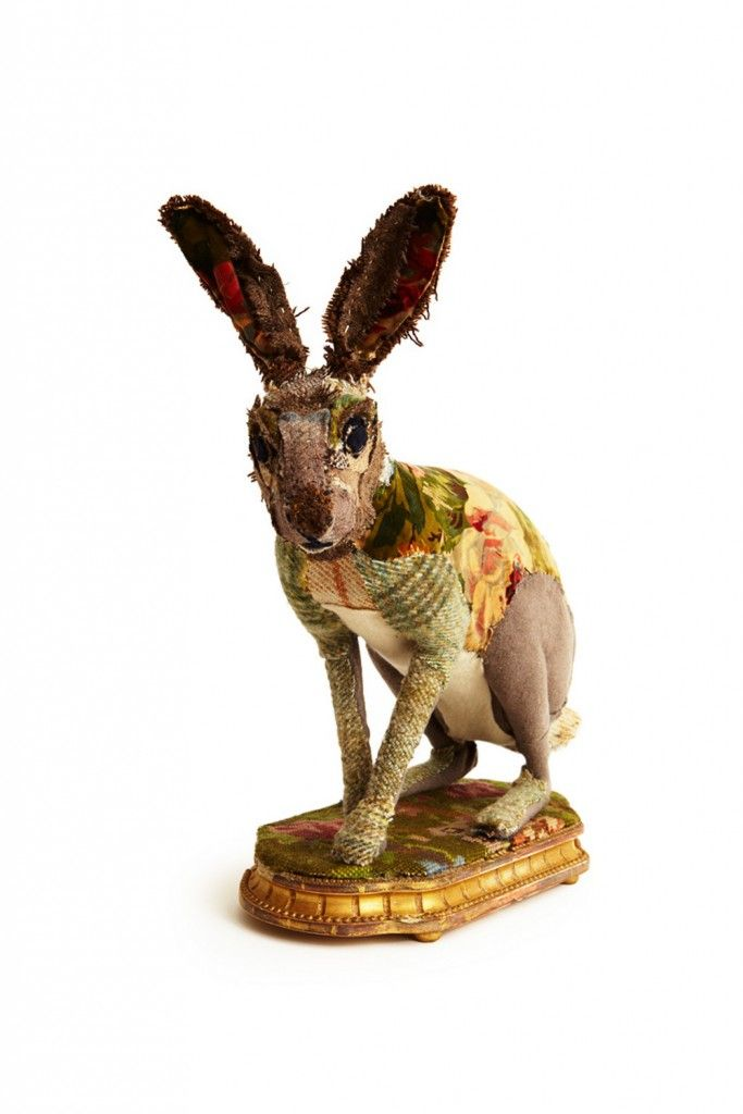 I love this idea! It makes me want to pull out fabric, sissors and some glue....Hare Fauxidermy